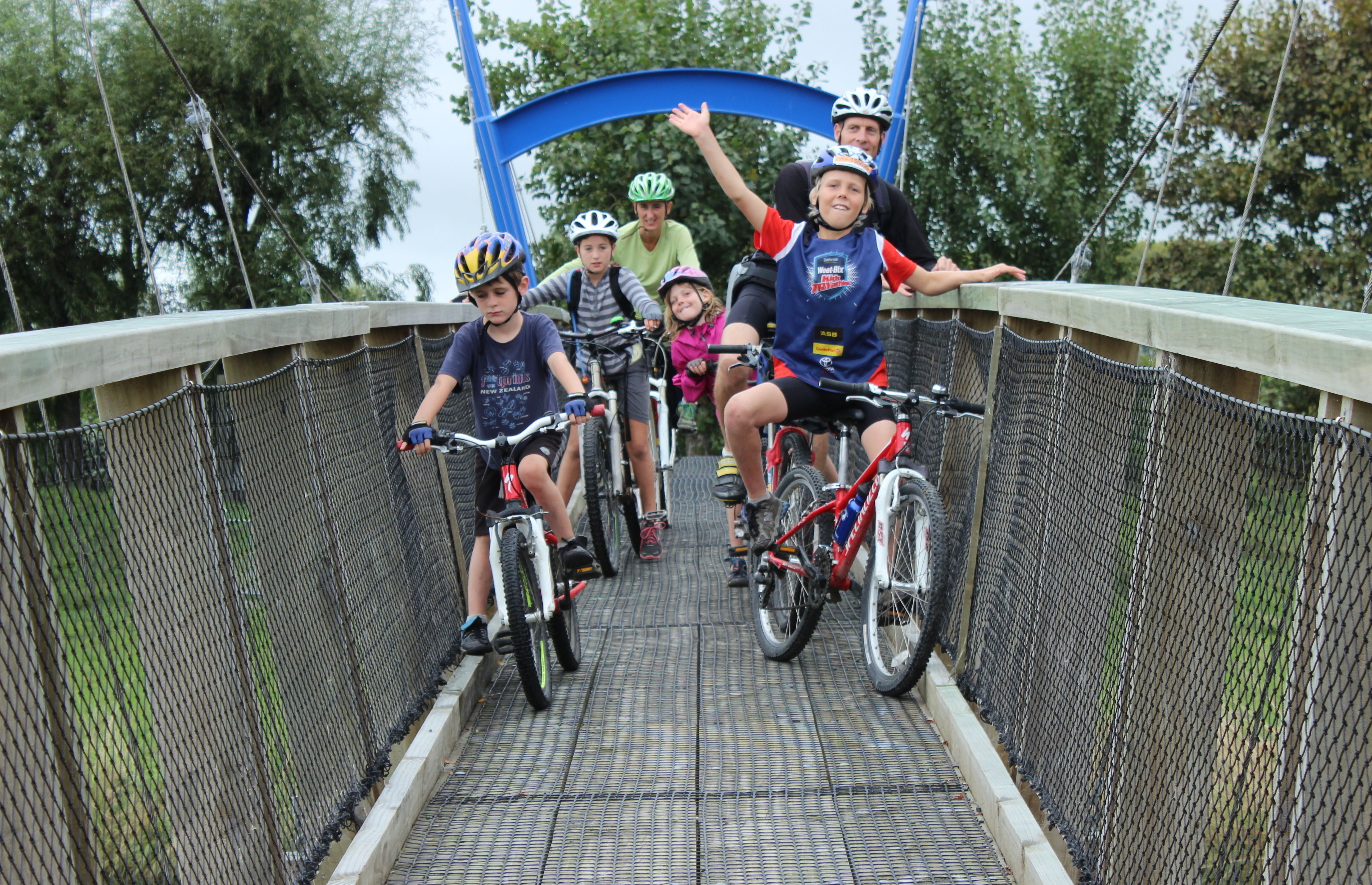 get inspired cycle kids Nelson Kaiteriteri Great Taste Bike Trail New Zealand bridge crossing goRide
