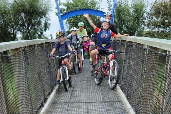 get inspired cycle kids Nelson Kaiteriteri Great Taste Bike Trail New Zealand bridge crossing goRide