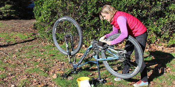 women cleaning bike bike brush goride