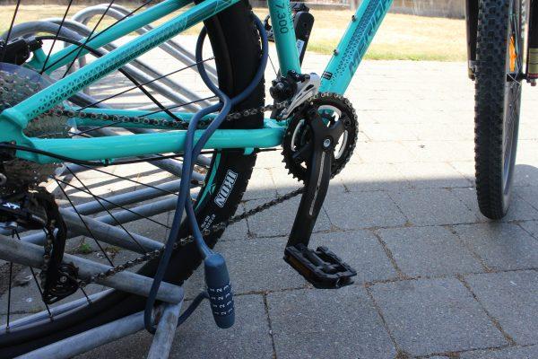 Coiled Combination bike lock fixed to bike rack. goRide
