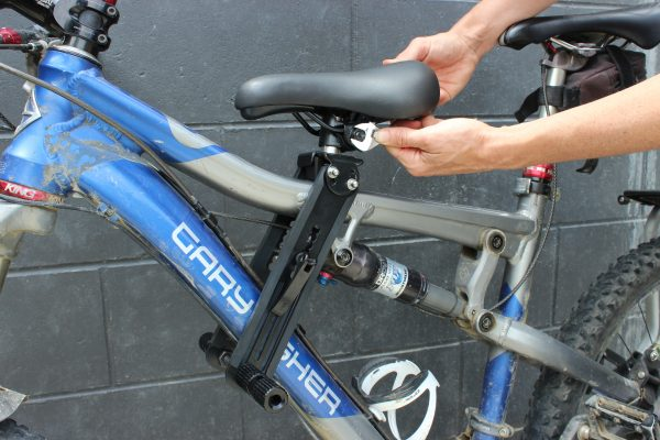 Tightening saddle bolts to hold in place