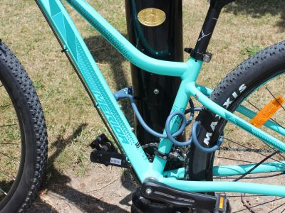 Coiled combination bike lock fixed to large lamp post. goRide