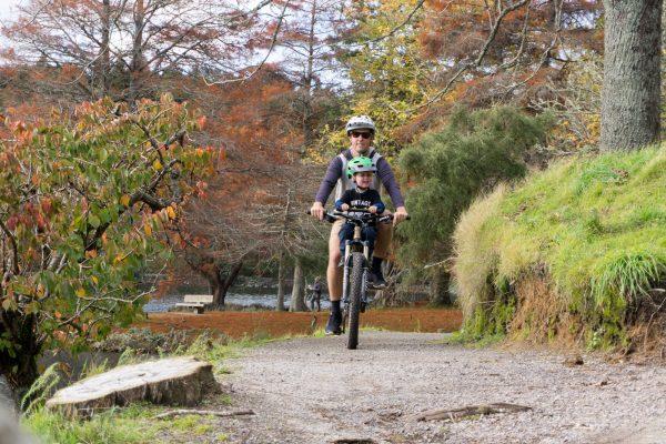 Shotgun on trail.  The best kids bike seats for Mountain Biking. goRide