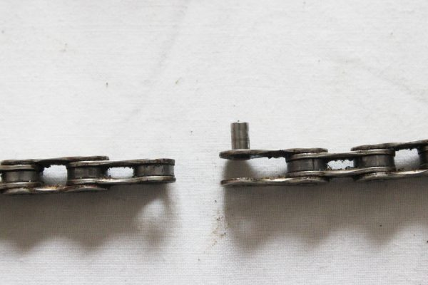 Outer and inner link with rivet still inserted