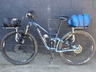 Thule bike carrier with waterproof bags and bungey cords