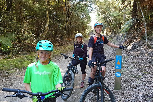 Family Ridng the timber trail signposting