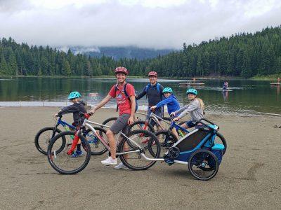 Family riding bike trailers. goRide
